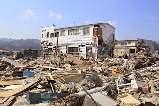 Building surrounded by rubble after the Tohoku earthquake