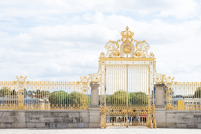 The gold gates of the Palace of Versailles.