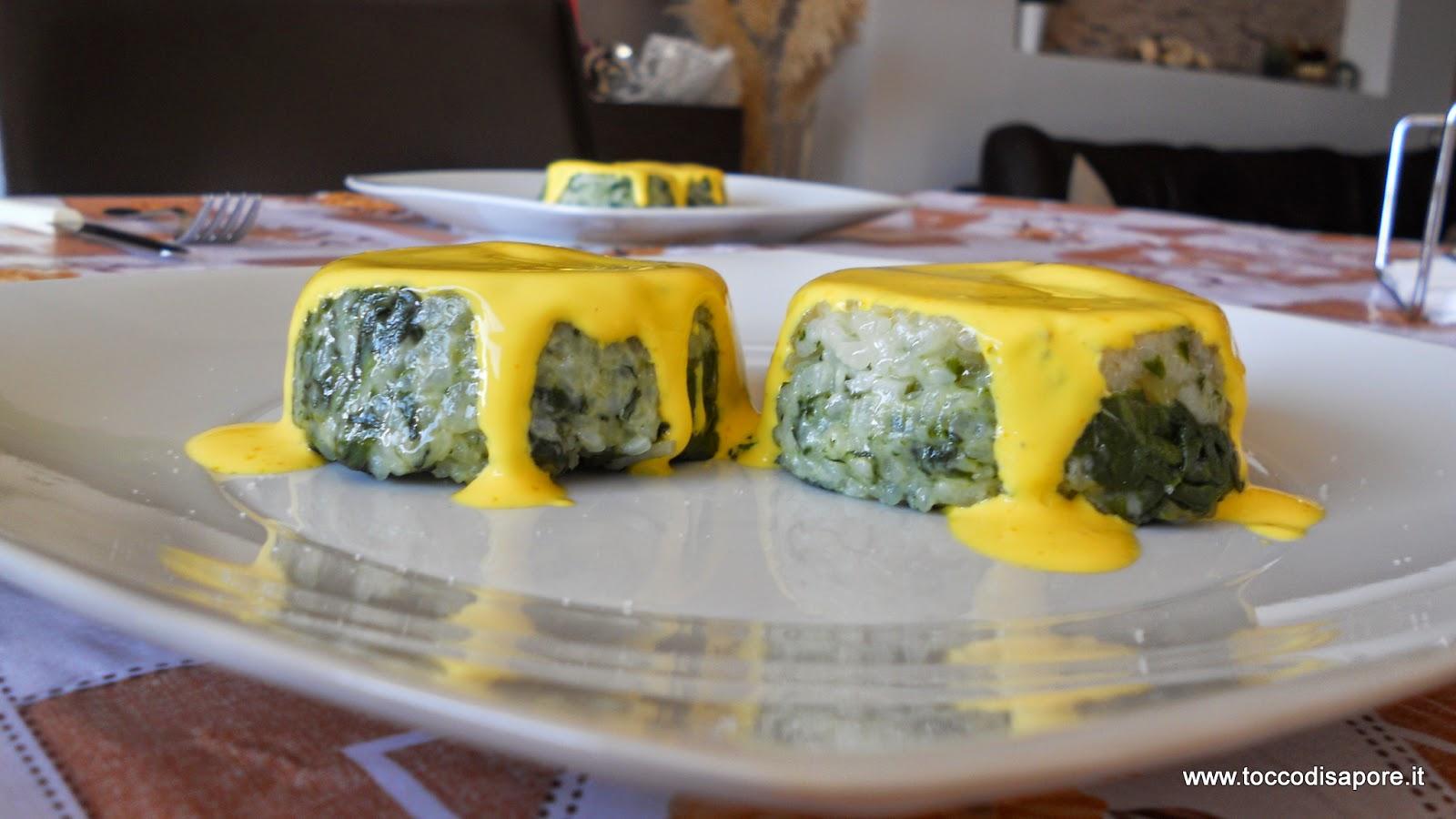 Tortini di risotto agli spinaci con fonduta di formaggio allo zafferano