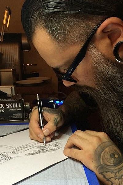 tattoo-artist Eric Gonzales