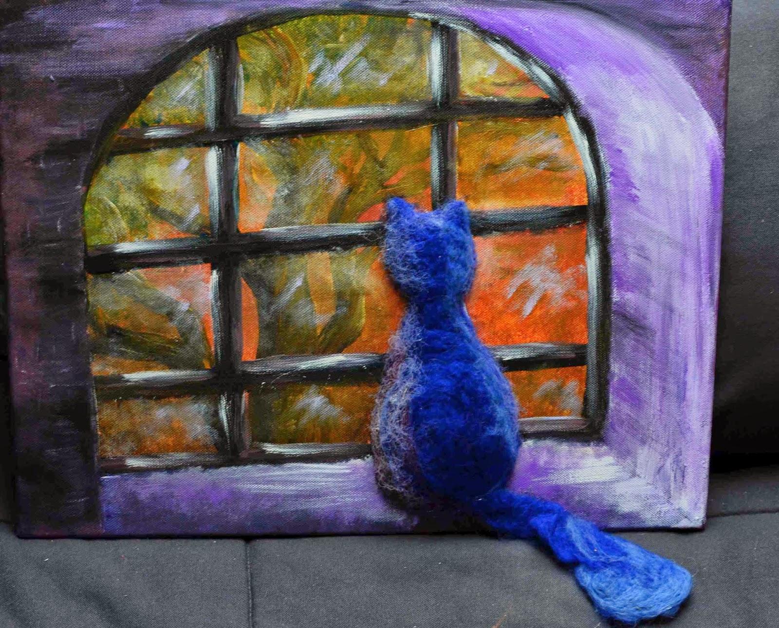 kot patrzący przez okno