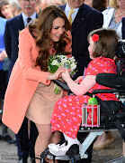 Kate received a bouquet from Sally Evans. Kate enjoyed talking to children . (nh )
