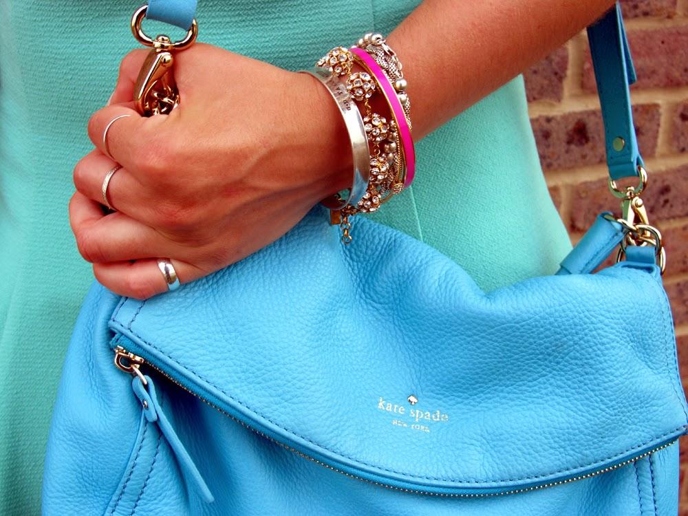 London fashion blogger Emma Louise Layla in bright blue pebble leather Kate Spade bag