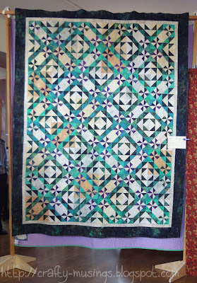Forest Canopy quilt hanging at the show