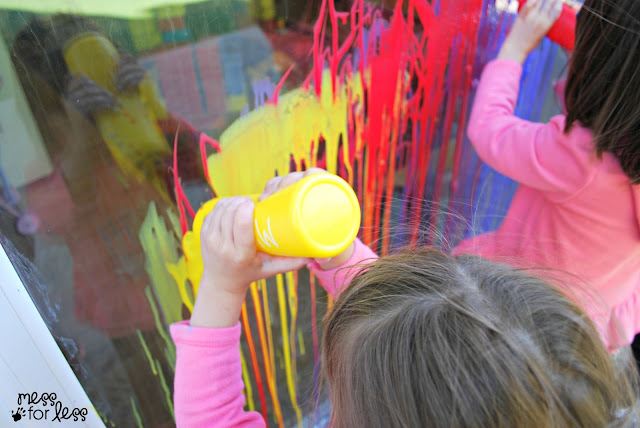 Painting a window with squirt bottles