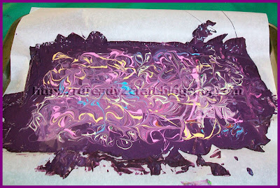 acrylic paint swirled into enamel base paint to create paint skin tiles for crafts