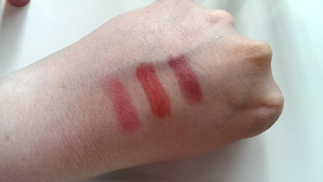 The three lip crayons swatched on the back of my hand