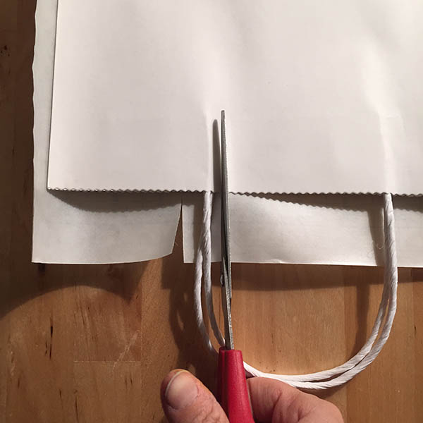 Cutting contact paper down to size around white craft bag
