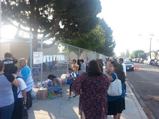 "ICEF Vista parents donating goods on the first day of school  to complete the ""volunteer"" requirement"