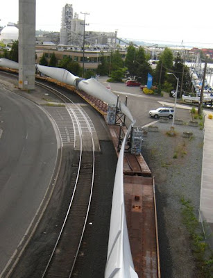 Wind turbine blades moving by train near Seattle