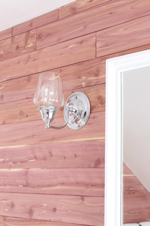 diy bathroom makeover clear glass sconces cedar planked walls