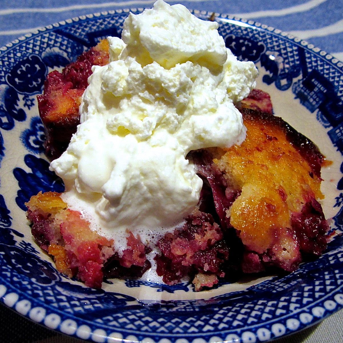 mixed berry cobbler with whipped cream