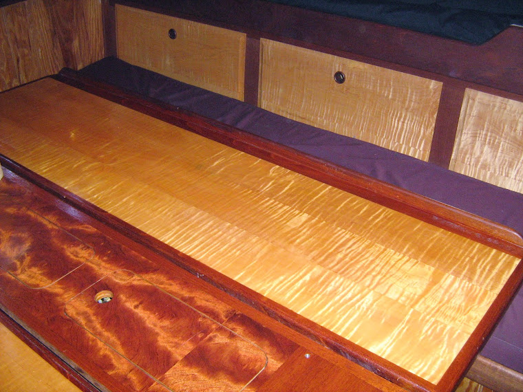 Build saloon table with leaves and build cabinets behind settee
