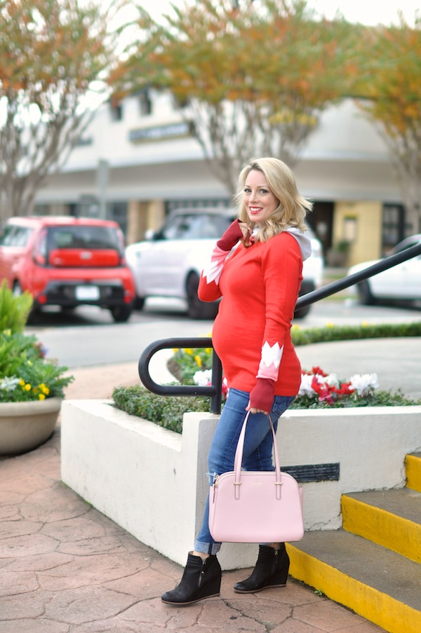 Festive red hooded sweater with pink and white on sleeves.  Pink Kate Spade purse.