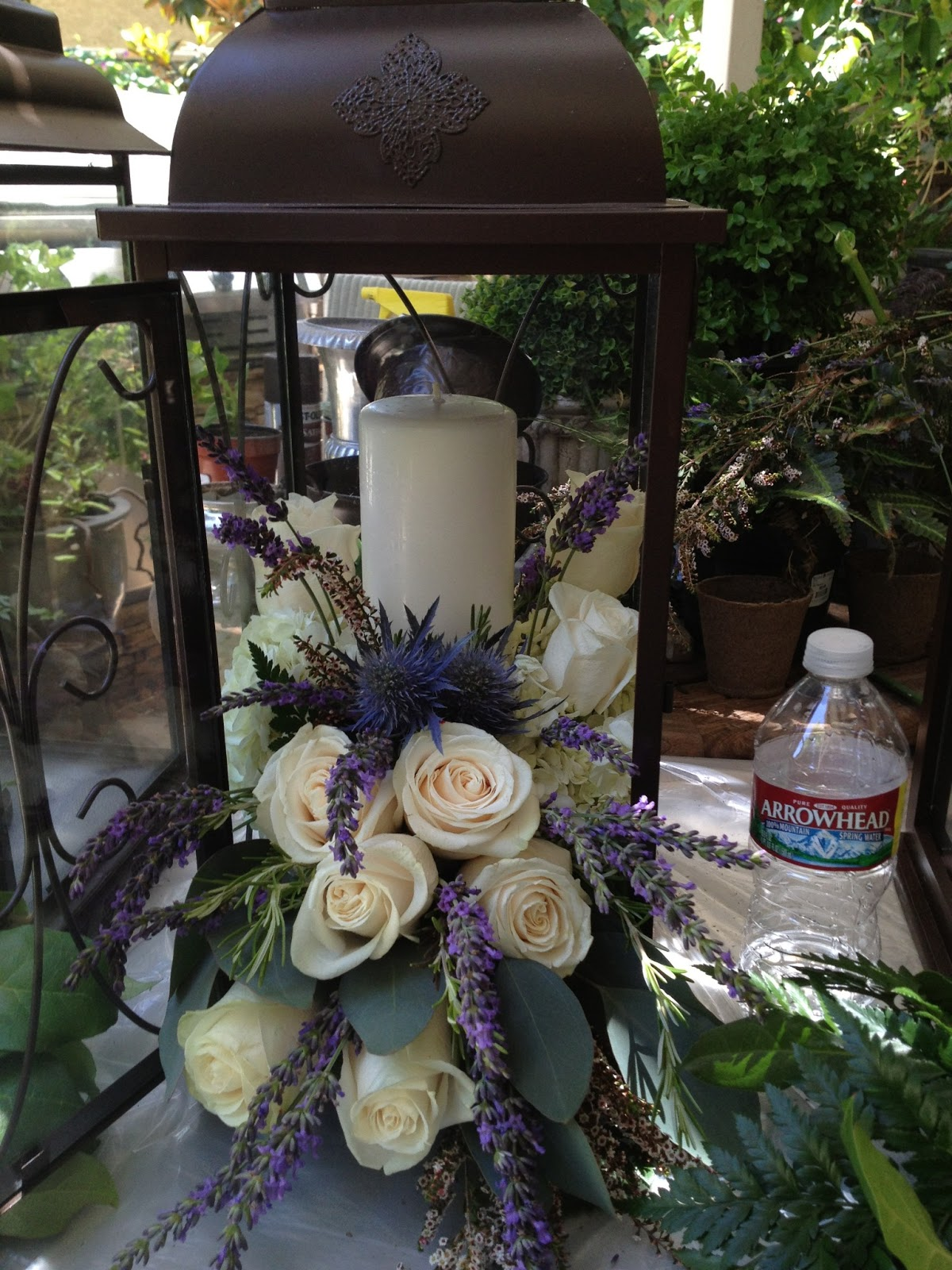 Classic diy bride illuminating centerpiece for Patio table centerpiece ideas