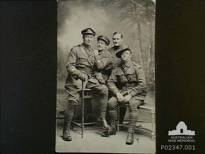Regimental Sergeant Major Albert Henry Percy Fleming seated on right