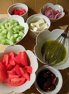 Bowls of Veggies, Cheese, Olives,  and Dressing