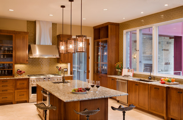 Picture of large modern kitchen with brown furniture and kitchen island in the middle