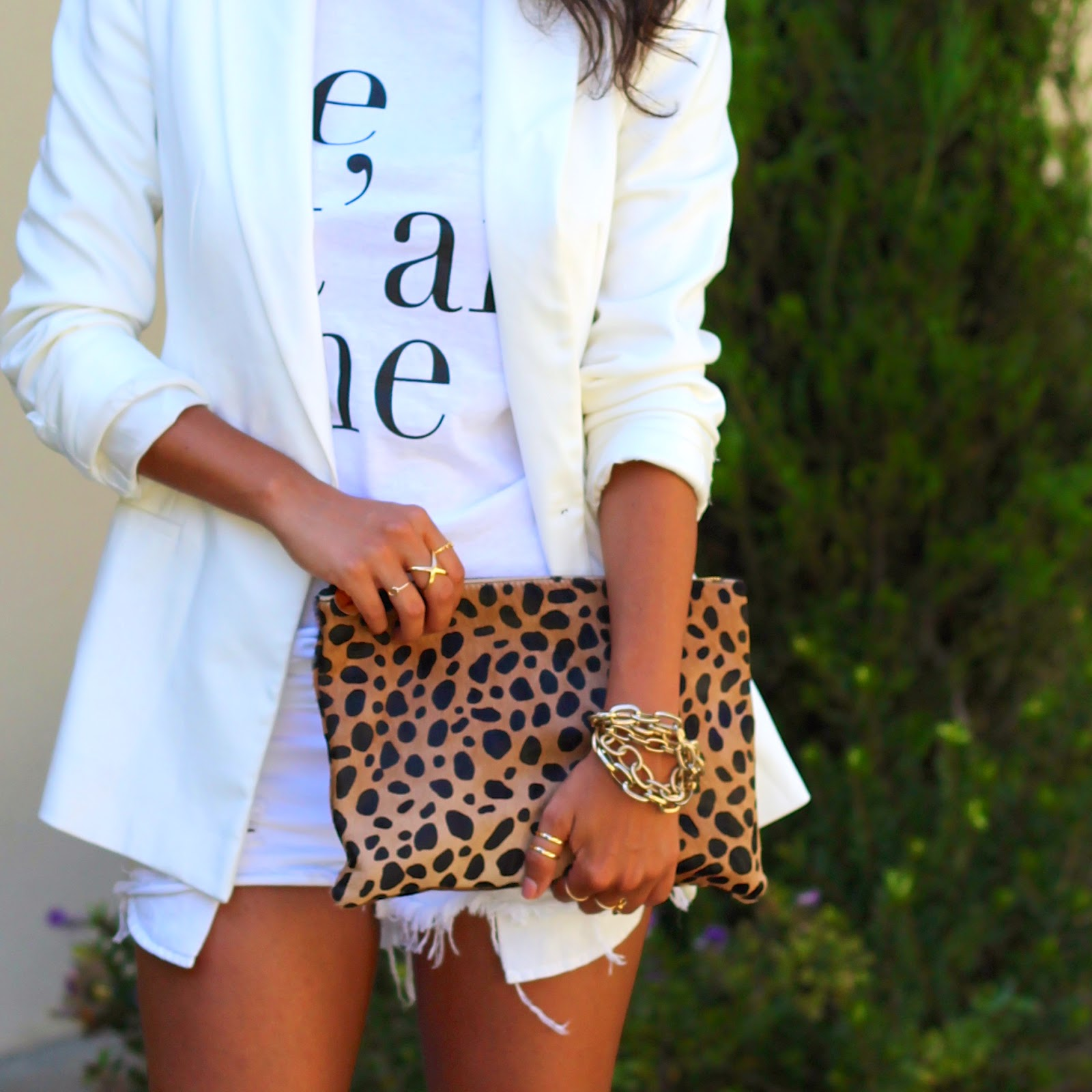 all white outfit, clare vivier clutch, leopard bag, graphic tee, what is fashion, cut-off shorts, heels