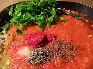 Sauce: adding tomato paste, thyme, oregano, parsley, salt and pepper