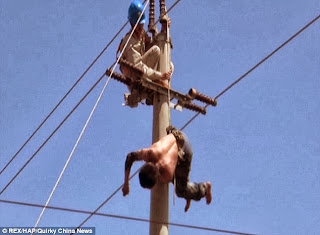 Jeez Man Gets Electrocuted On a Power Line.