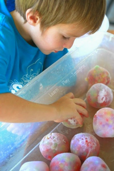 Frozen water bead rocks for sensory and gross motor play