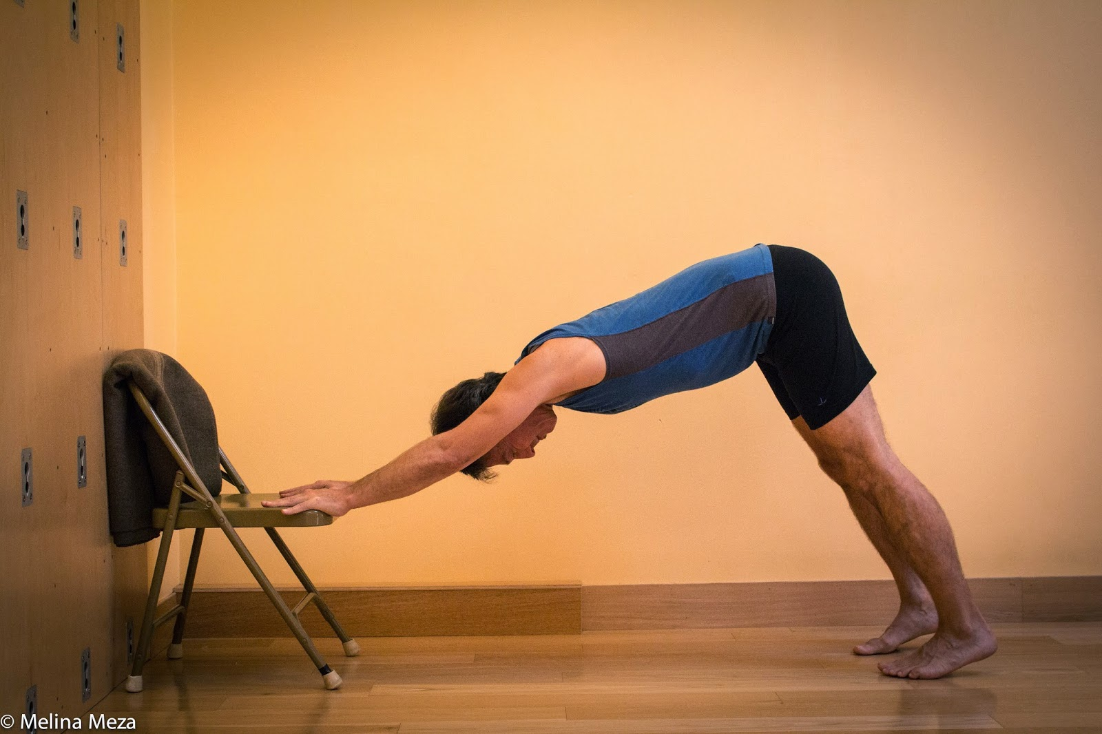 image of downward dog using a chair