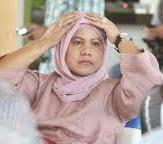 Foto Iriana Istri Jokowi Tutup dan Buka jilbab