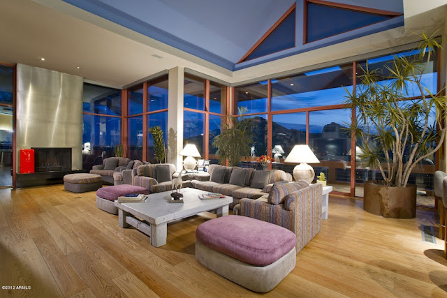 Living room with large floor to ceiling windows