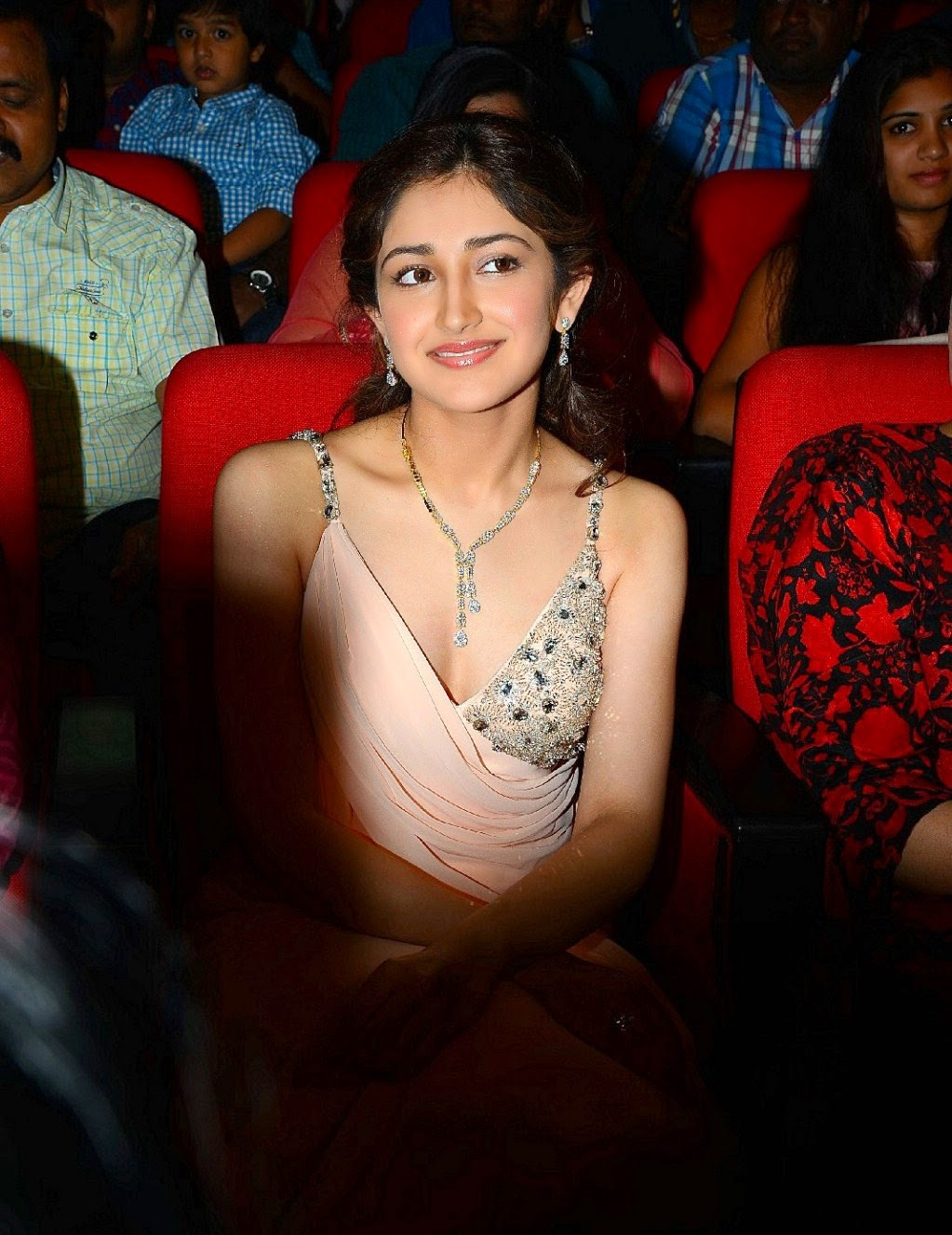 Sayesha Saigal in Lovely Skin Color Deep Neck Designer Gown Stunning Beauty at Akhil Movie Launch Event