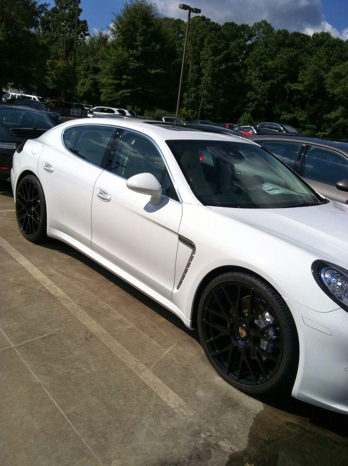 Black Panamera With Black Rims Winter White With Black Rims…