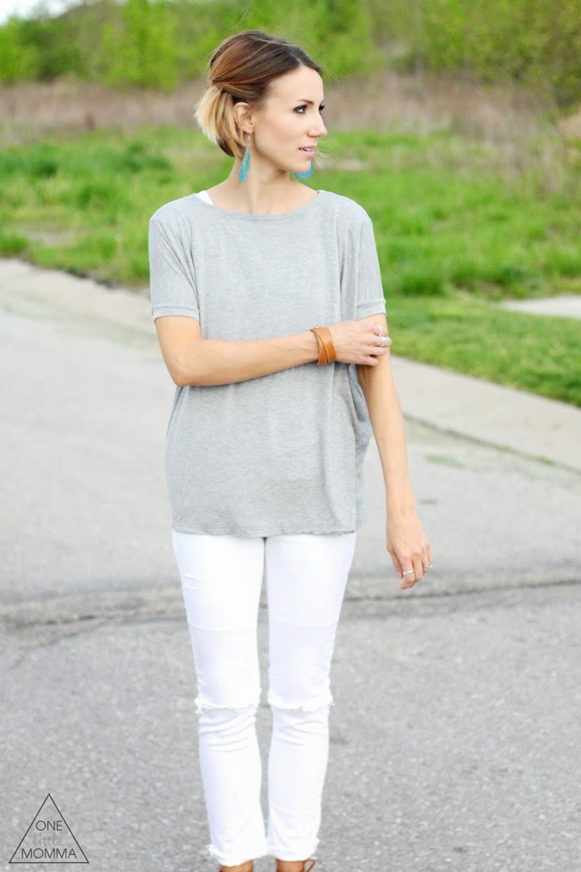 Distressed white jeans, over sized gray tee and brown sandals