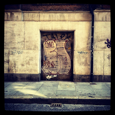 Graffiti on rusty door - Turin, Italy