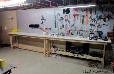 great basement workshop, woodshop, bench, tool peg board
