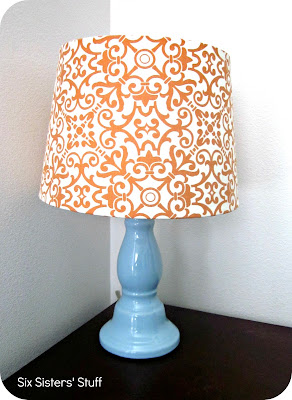A lamp with a fabric-covered shade