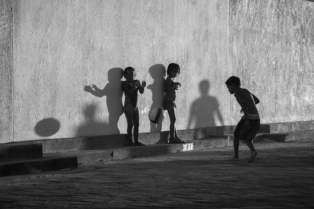 Street photograph of children playing with ball - Seapoint Cape Town