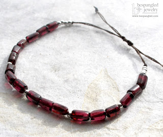 handmade simple garnet bracelet with sterling silver beads on knotted brown silk cord