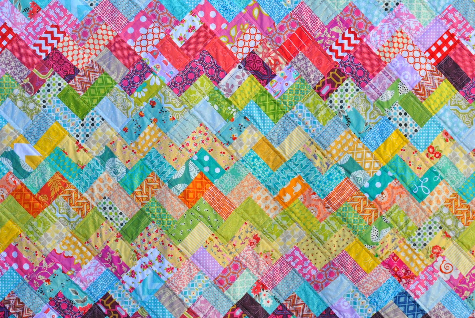 scrappy chevron quilt close
