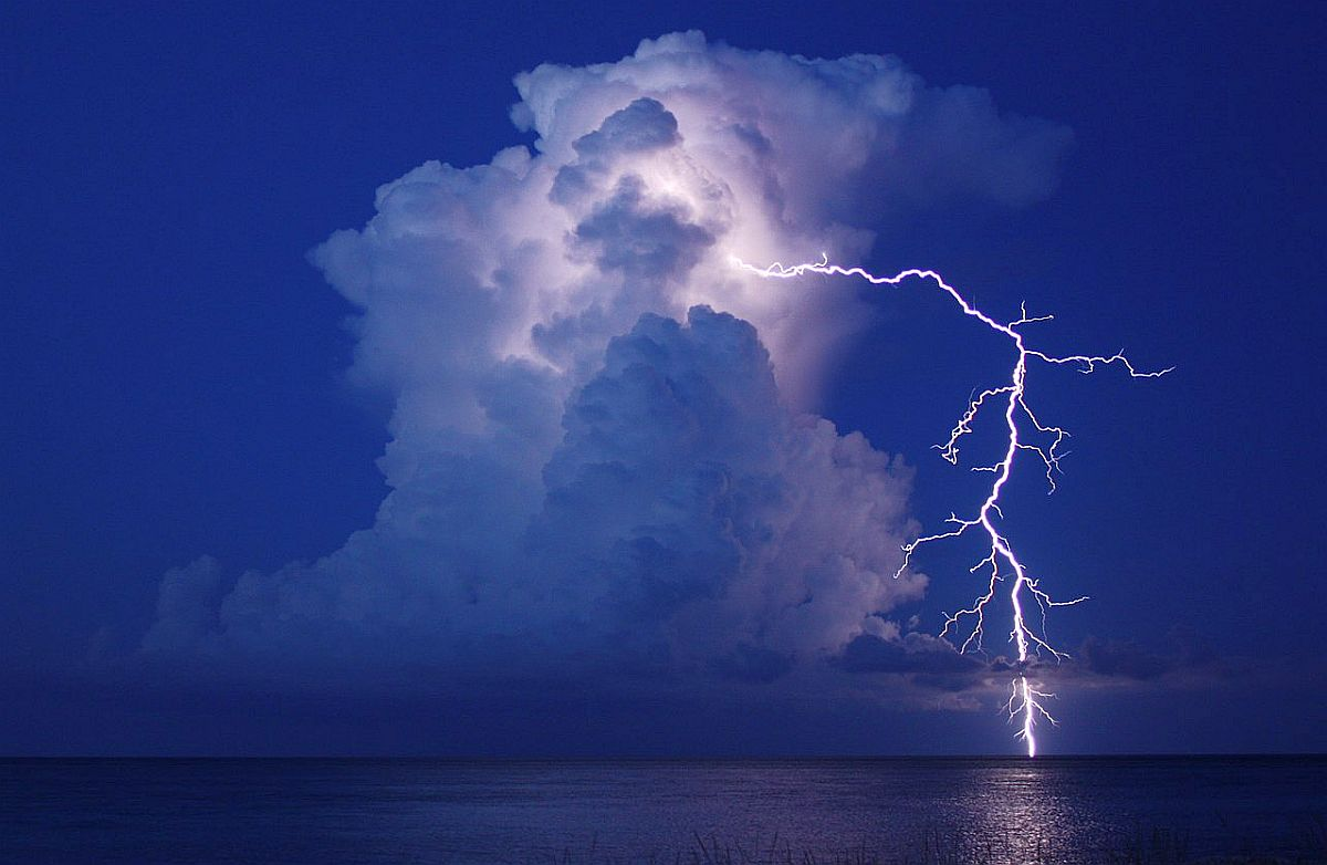 thunderstorm high clouds lightning lake nature peace mind