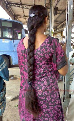 Indian college girl with very long hair braid waiting for her college bus.