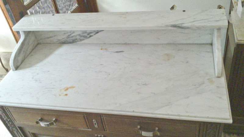 Upon close inspection, the vanity marble is in worse condition than I  title=