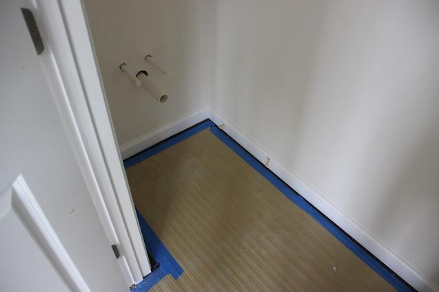 Flooring in the Matisse powder room complete