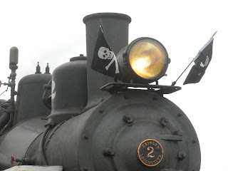 Photo of steam locomotive with pirate flags