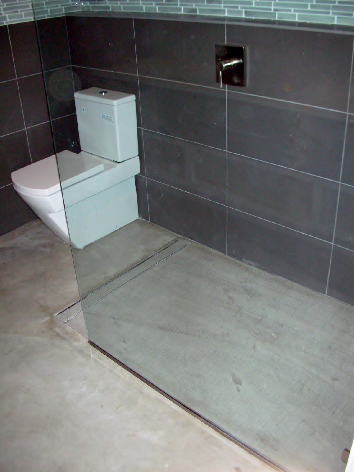 Bathroom Tile Floor Drain : Mode concrete modern open concept bathroom featuring a