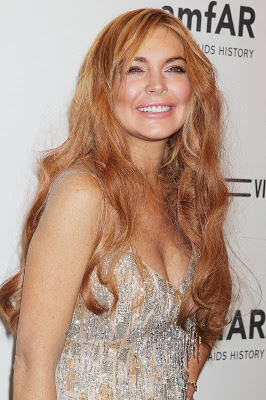 Lindsay Lohan wear vintage Roberto Cavalli gown when attend at the 2013 amfAR Gala in New York