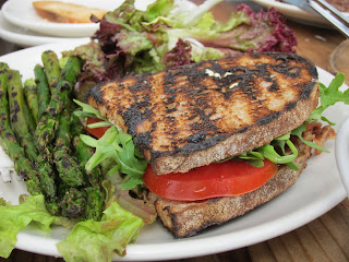 pancetta sandwich served with grilled asparagus