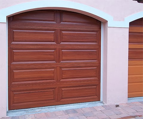 Three garage doors finished everything i create paint for Garage doors that look like wood
