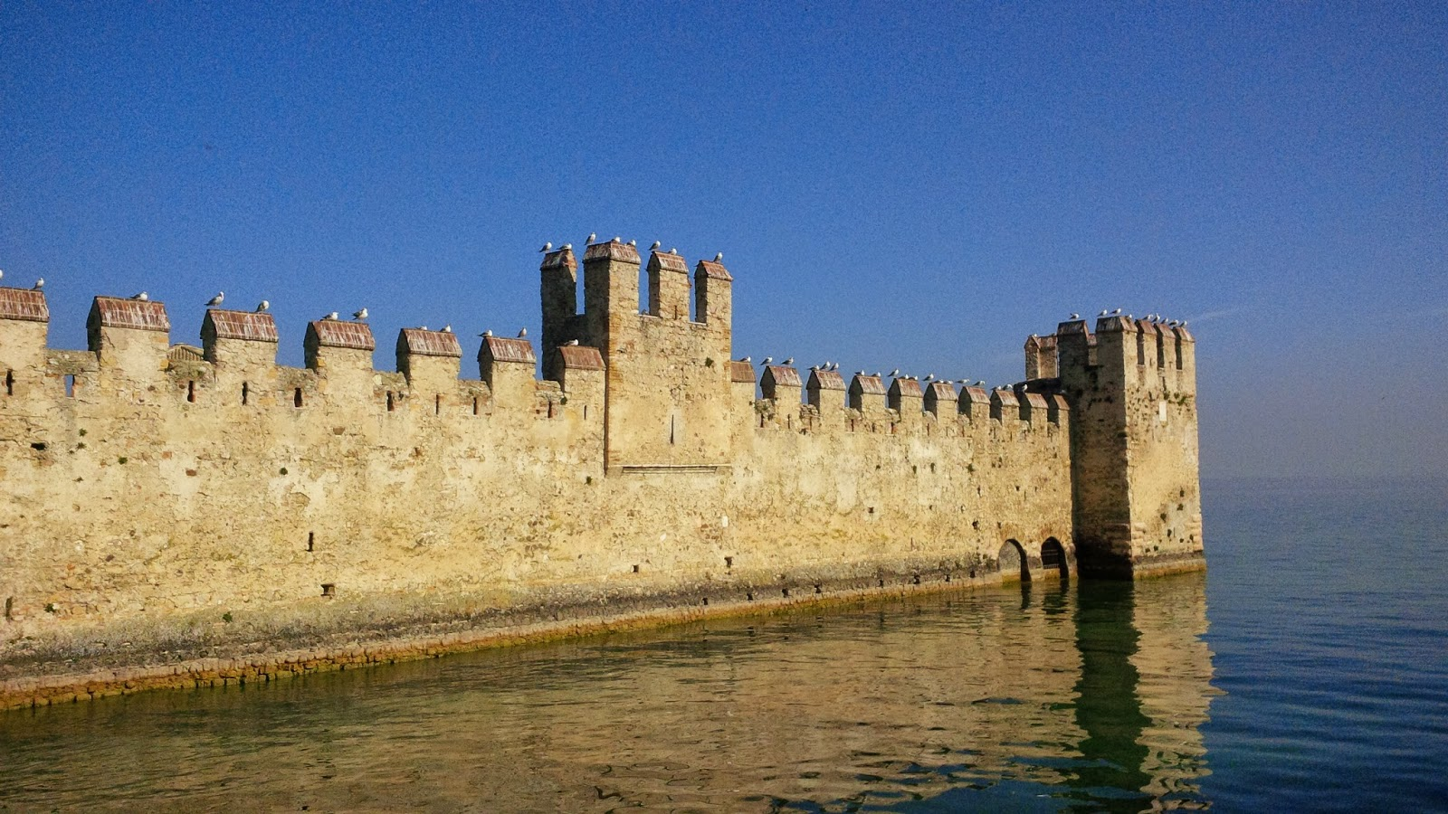 Sirmione's castle extending into lake Garda