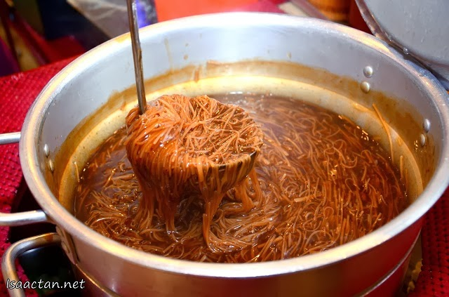 Handmade Oyster Mee Sua being scooped fresh from the pot