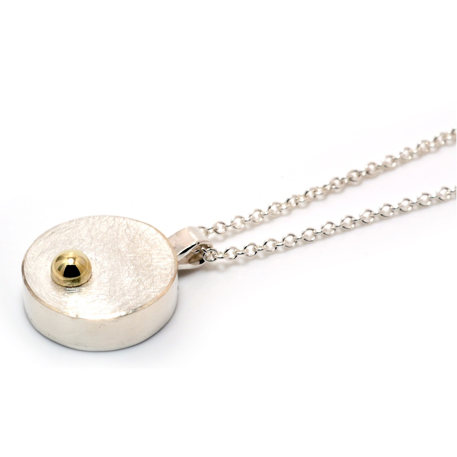 http://jam-eton.co.uk/machi-de-waard-silver-with-embedded-gold-ball-mini-pendant.html